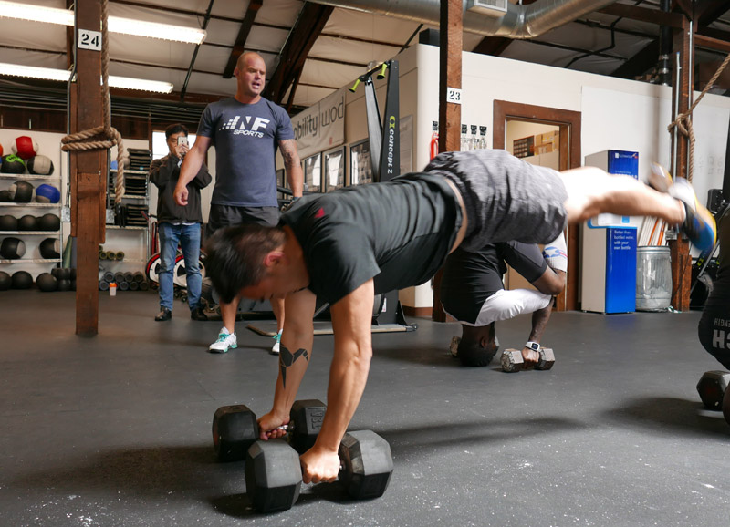 Kelly Starrett leading a workout session with Toan Lam